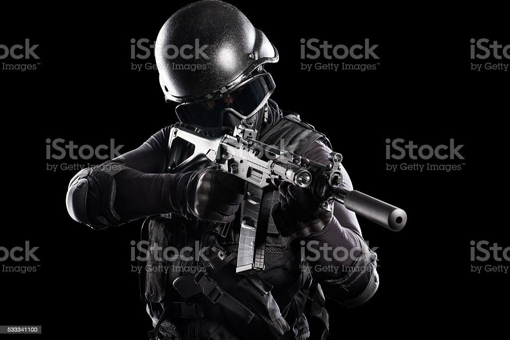 Soldier aiming with a rifle stock photo
