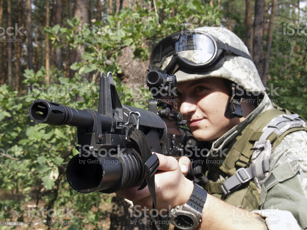 Soldier aiming with M4 carbine stock photo