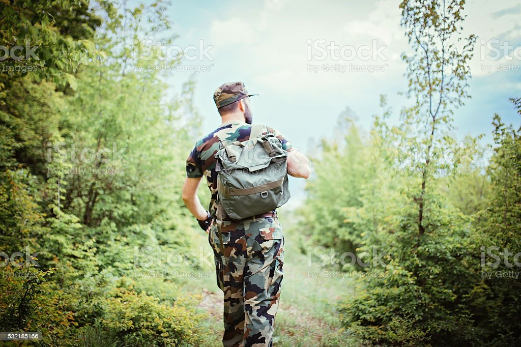Soldier alone in the mountains stock photo