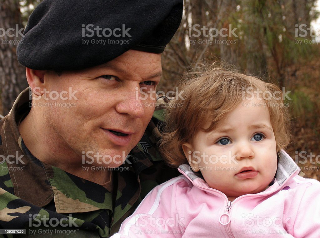 Soldier and Baby royalty-free stock photo