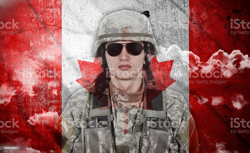 soldier and canada flag stock photo