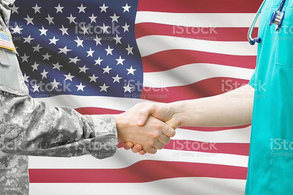 Soldier and doctor with flag on background - United States stock photo