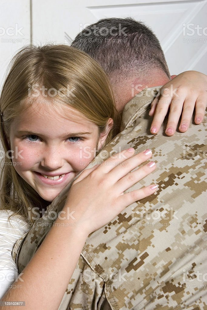 Soldier and his daughter royalty-free stock photo