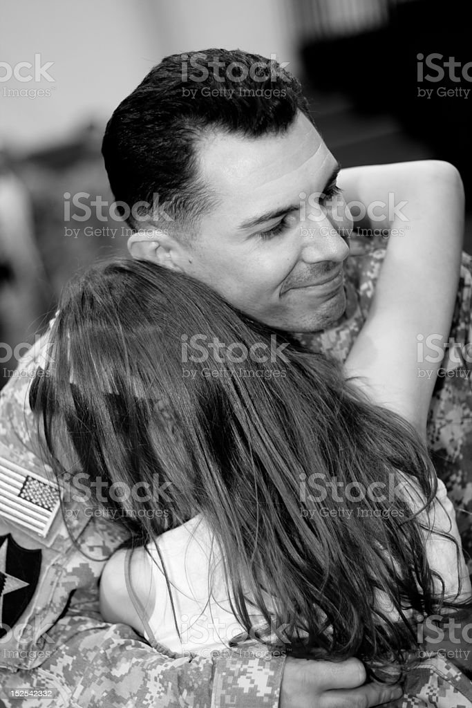 Soldier and his daughter stock photo