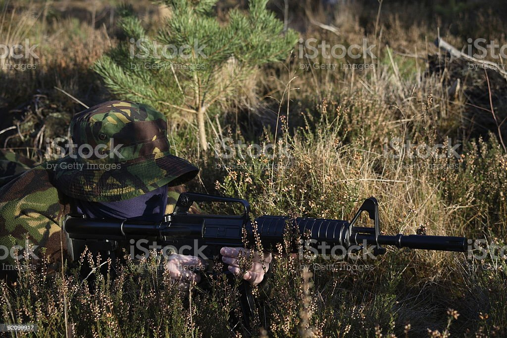 Soldier and his Rifle (Side view) royalty-free stock photo