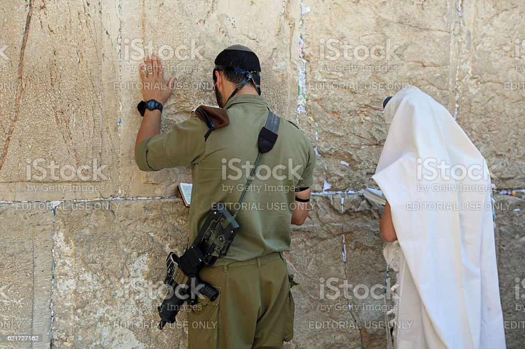 Soldier and jewish Prayer at the Western Wall stock photo