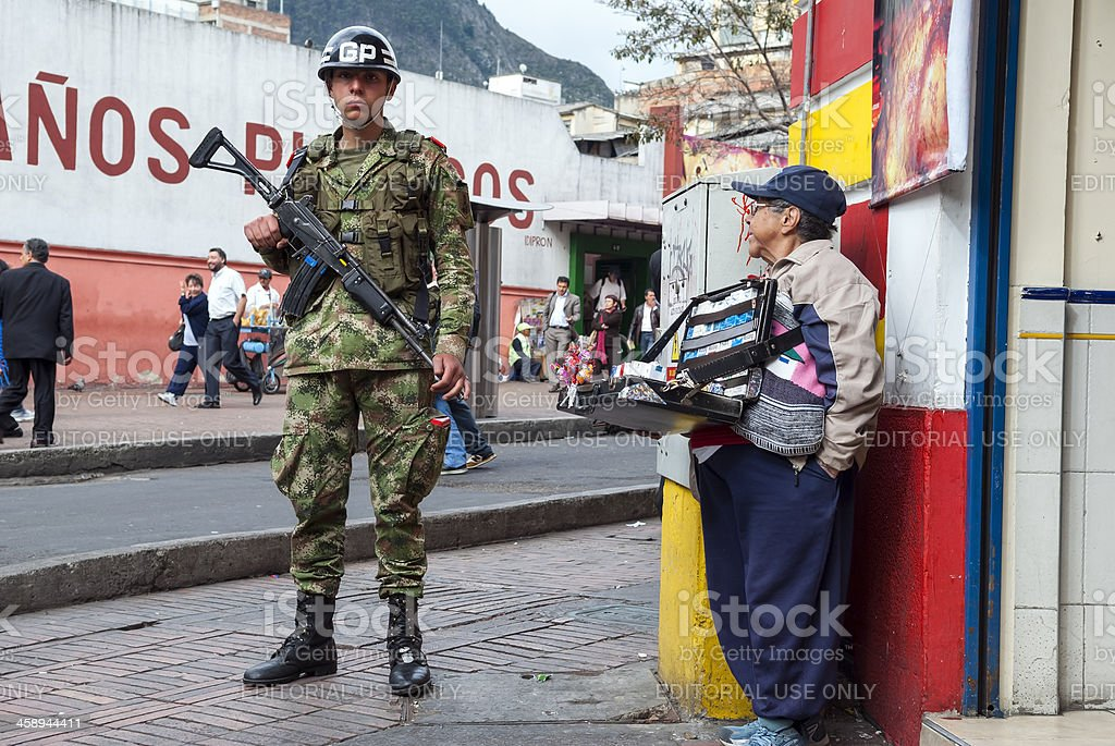Soldier and small businessperson in Bogota, Colombia royalty-free stock photo