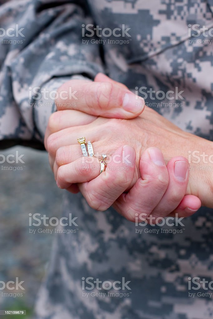 Soldier and wife's hands stock photo