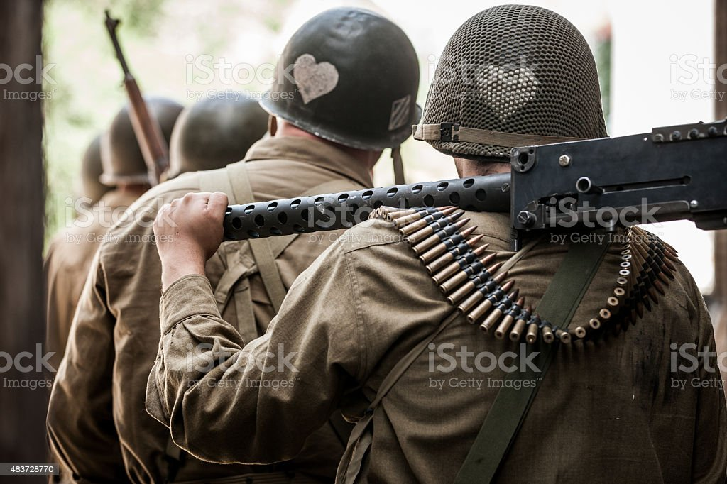 WWII Soldier Carrying Machine Gun stock photo