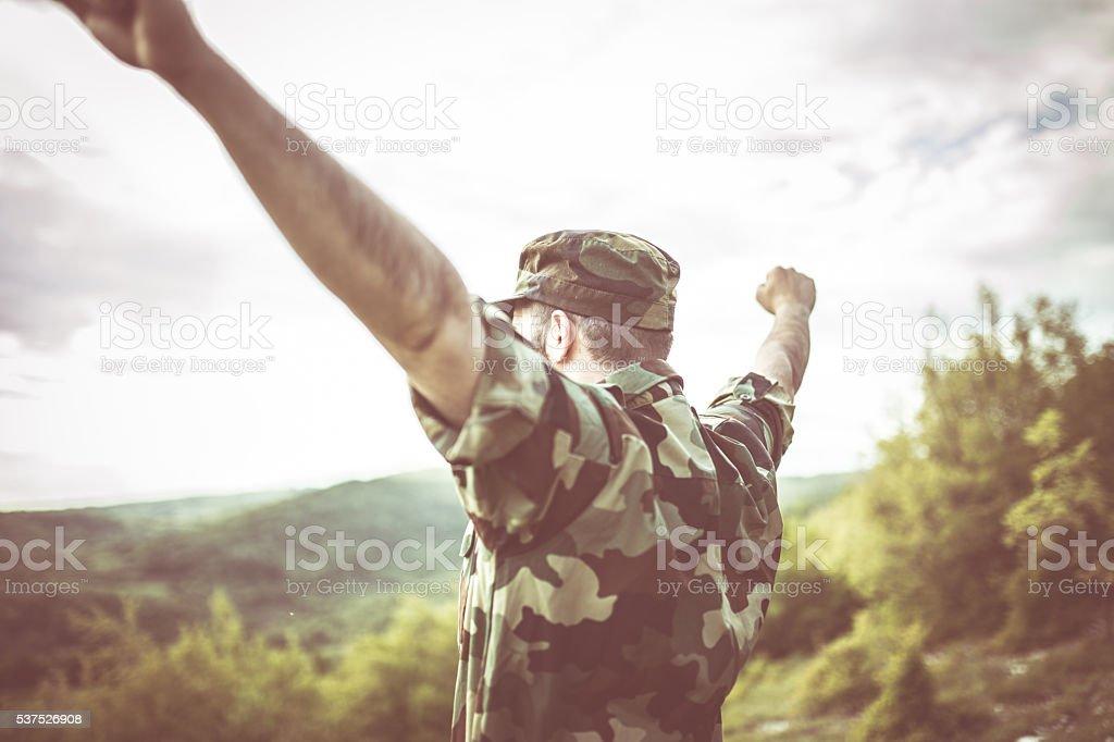 Soldier celebrating freedom stock photo
