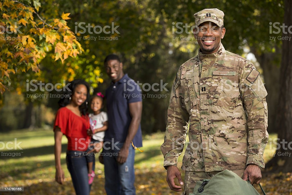US Soldier comes home from deployment to family royalty-free stock photo