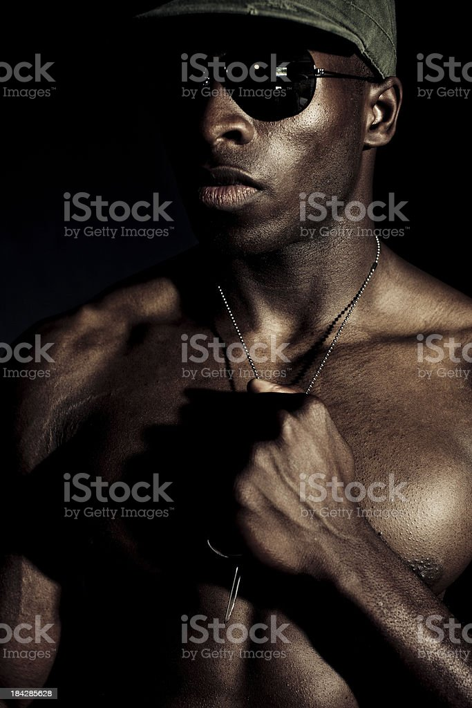 soldier coming from the shadows royalty-free stock photo