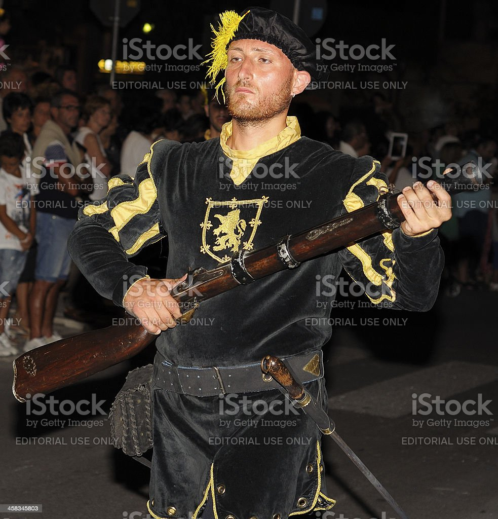 Soldier firing a blunderbuss parade in historic costumes royalty-free stock photo
