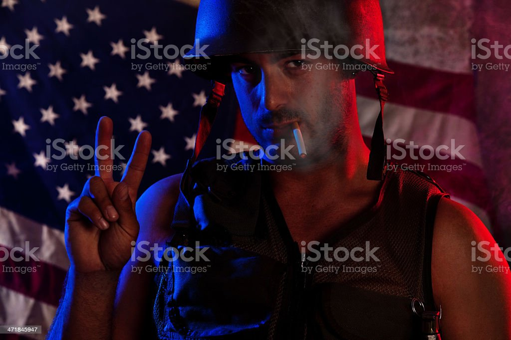 Soldier Flashing Peace Sign royalty-free stock photo
