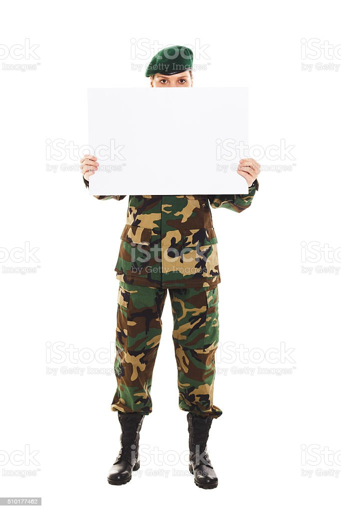 Soldier girl in the military uniform stock photo
