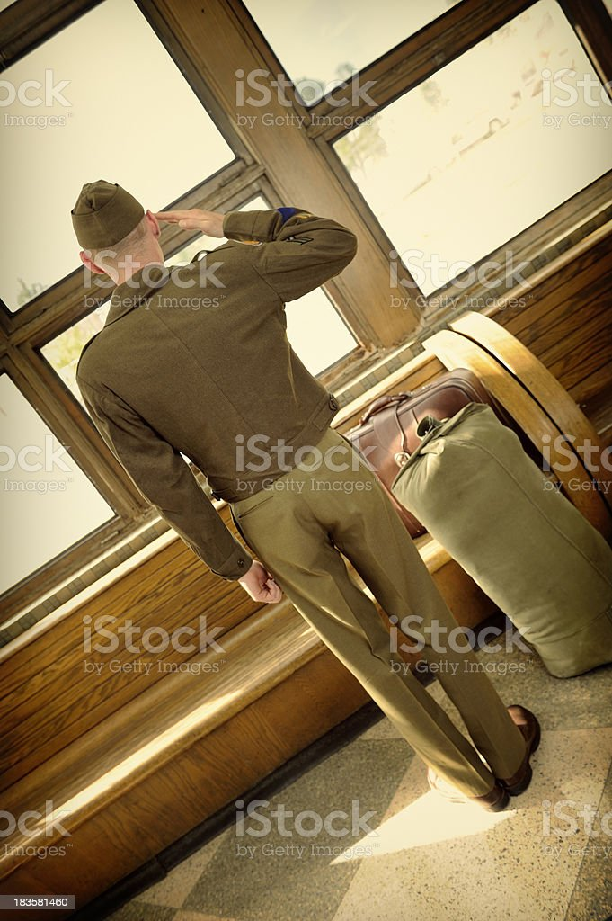 WWII Soldier Giving A Lonely Salute - Back View stock photo