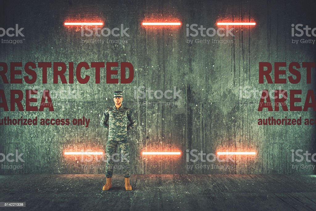 Soldier guarding restricted military area stock photo