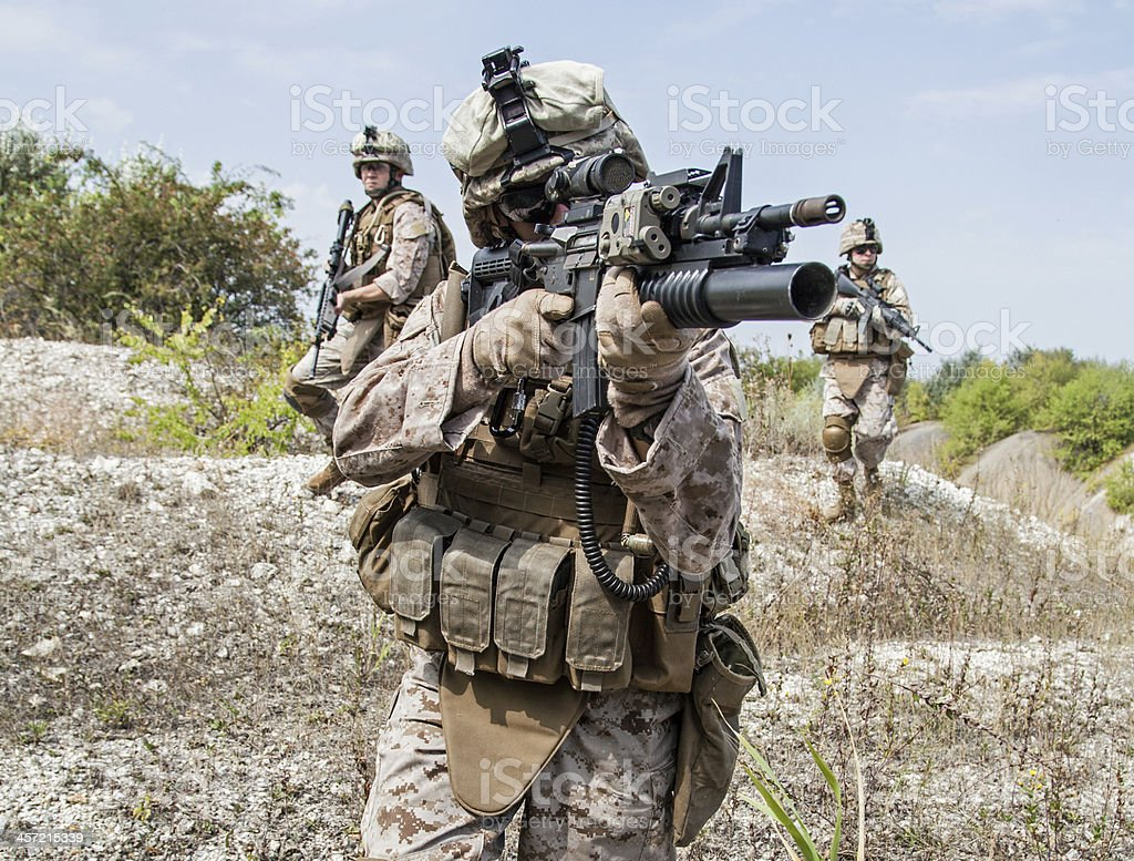 Soldier holding a gun in military operation royalty-free stock photo