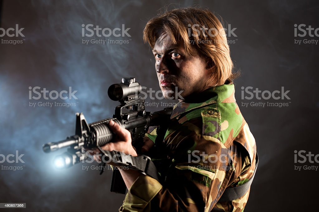 soldier holding a weapon stock photo