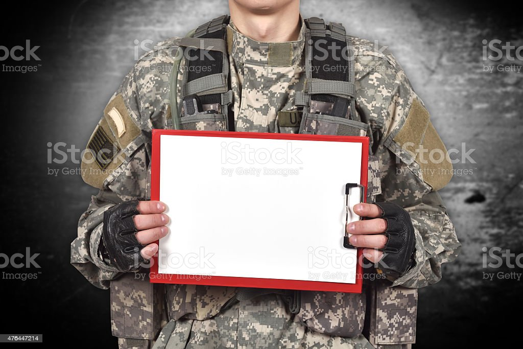 soldier holding blank clipboard stock photo