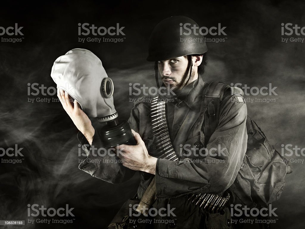 Soldier holding gas mask royalty-free stock photo