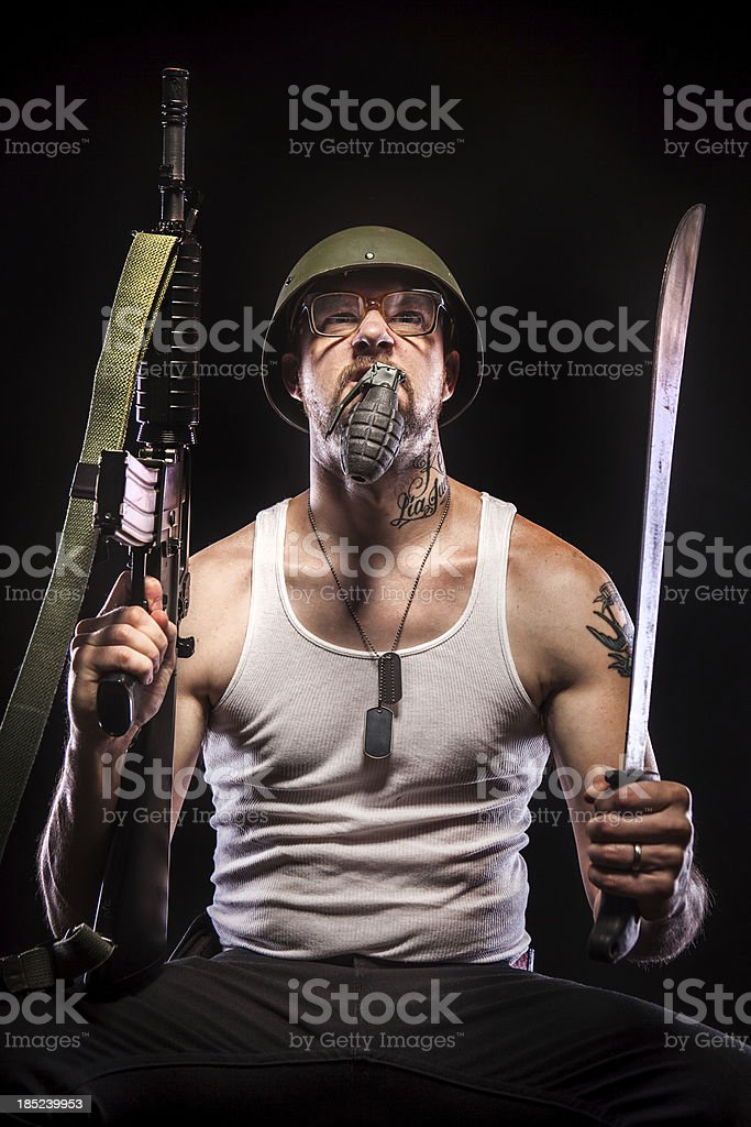 Soldier Holding Grenade in Mouth, Glasses, Dog Tags,  Weapons stock photo