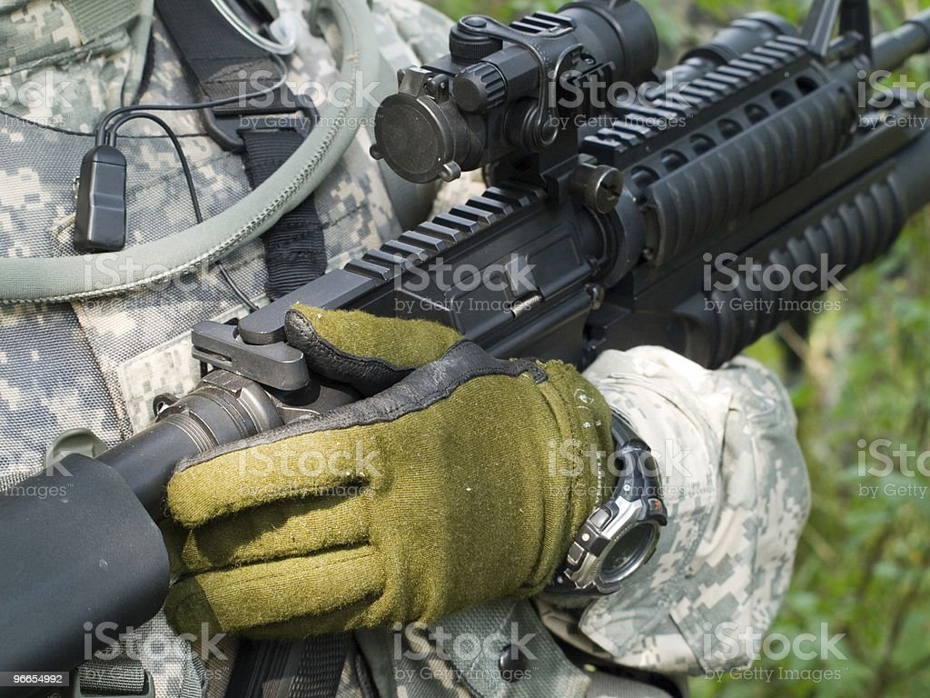 Soldier holding his rifle royalty-free stock photo