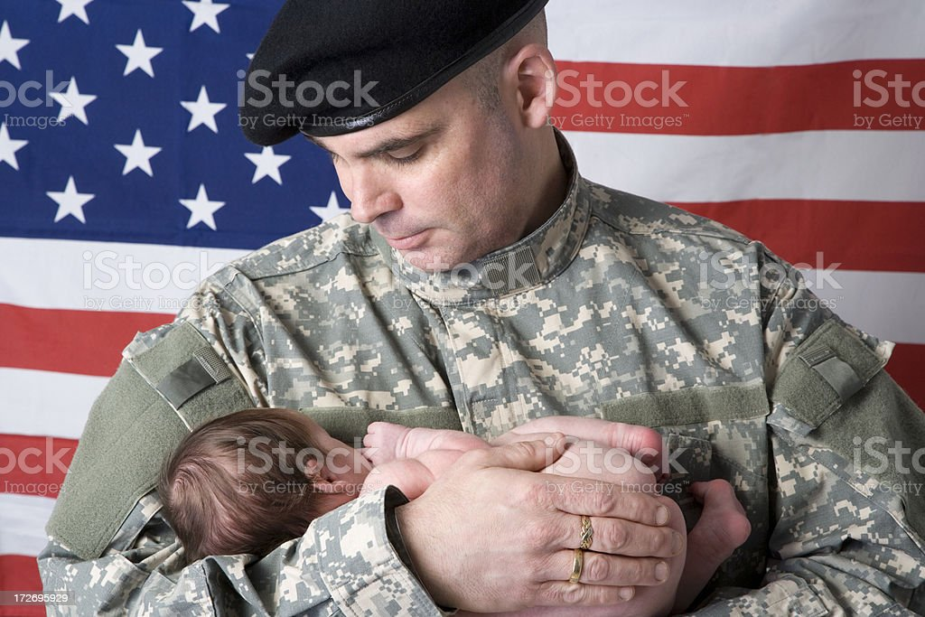Soldier holding his son royalty-free stock photo