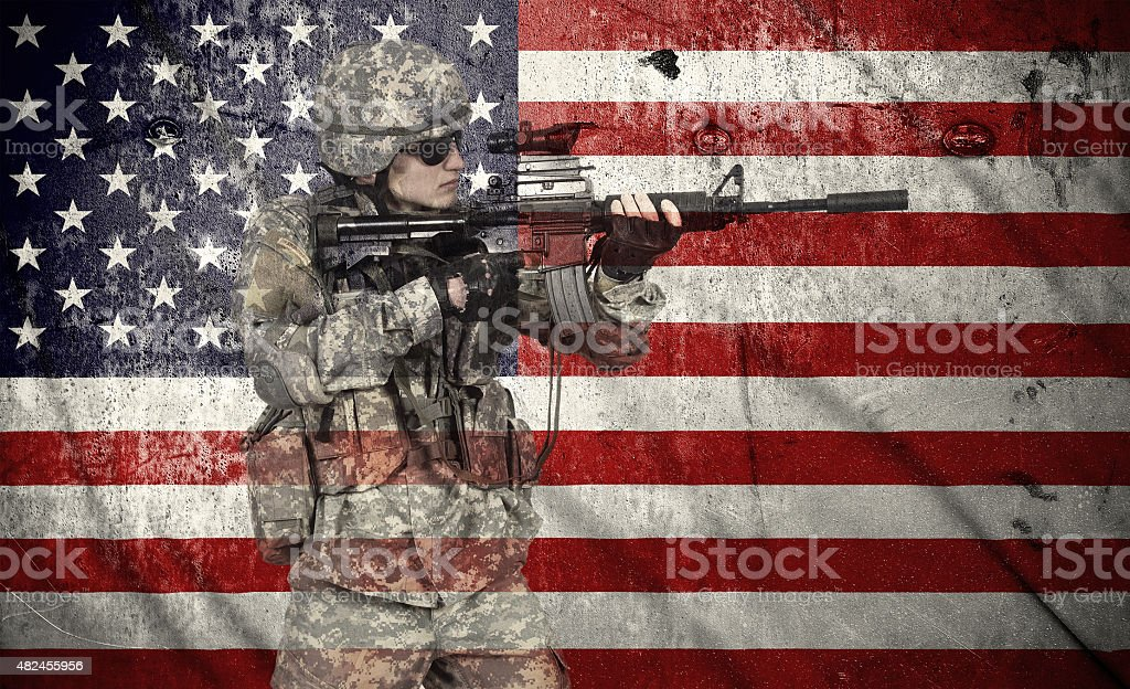 soldier holding rifle stock photo
