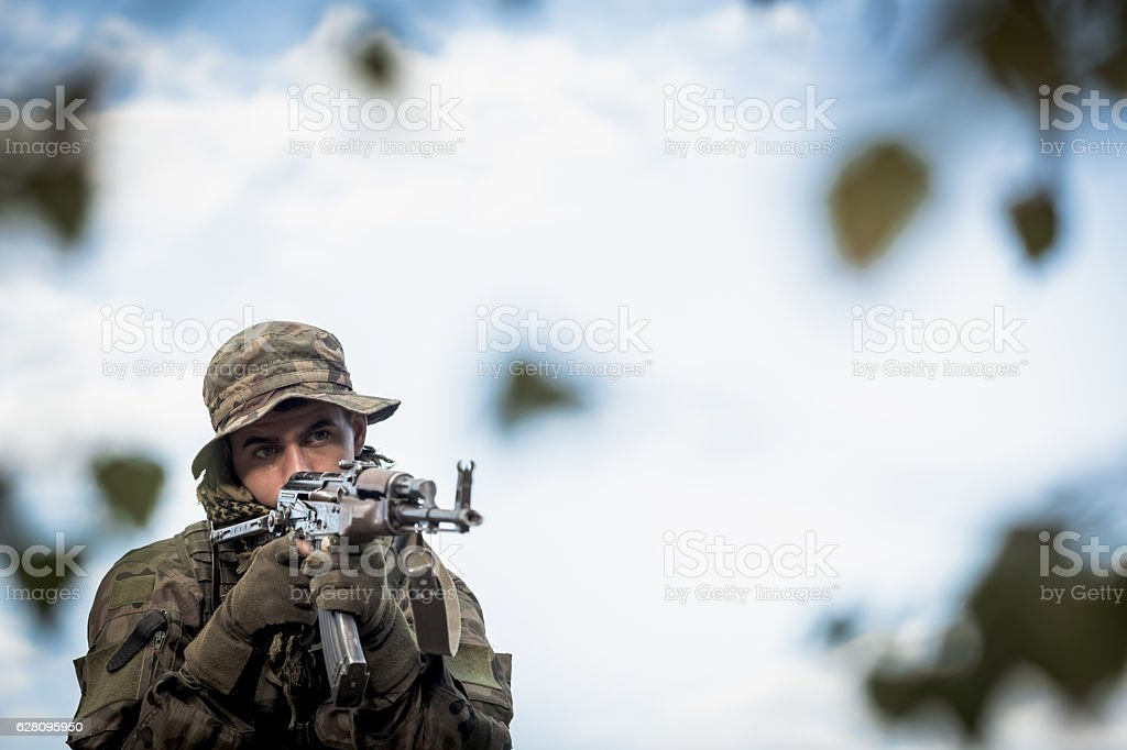 Soldier holding weapon stock photo