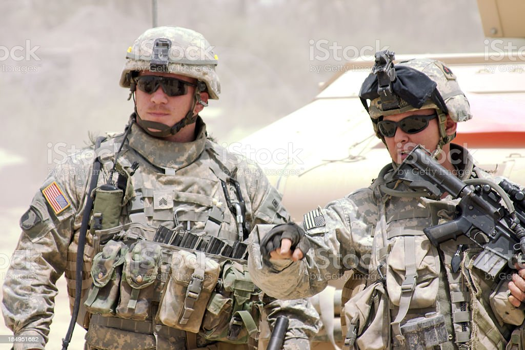 A soldier in a war zone giving orders stock photo