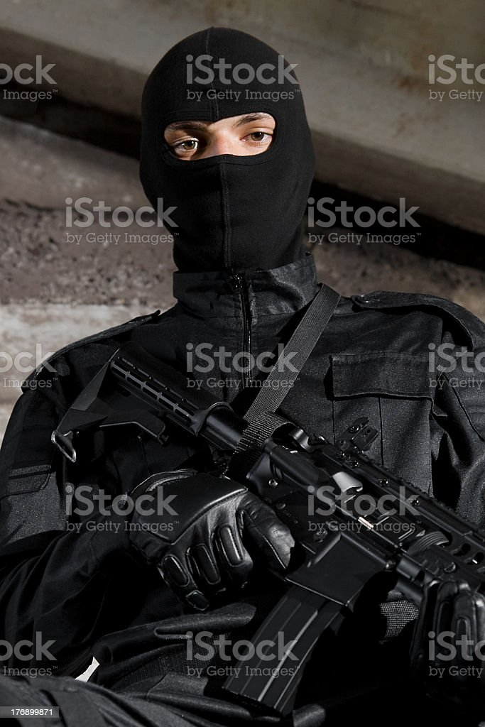 Soldier in black uniform with a gun royalty-free stock photo