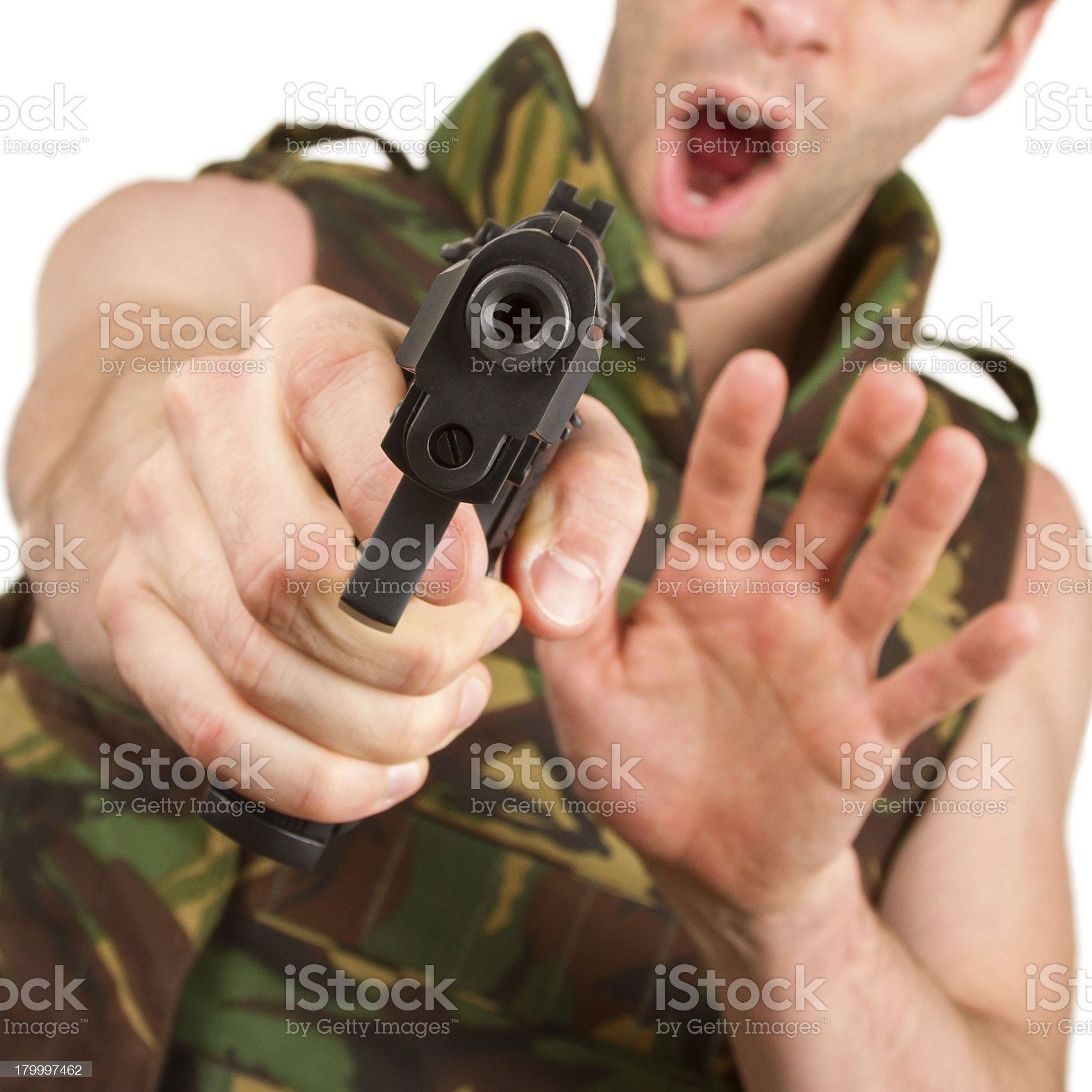 Soldier in camouflage vest is holding a gun royalty-free stock photo