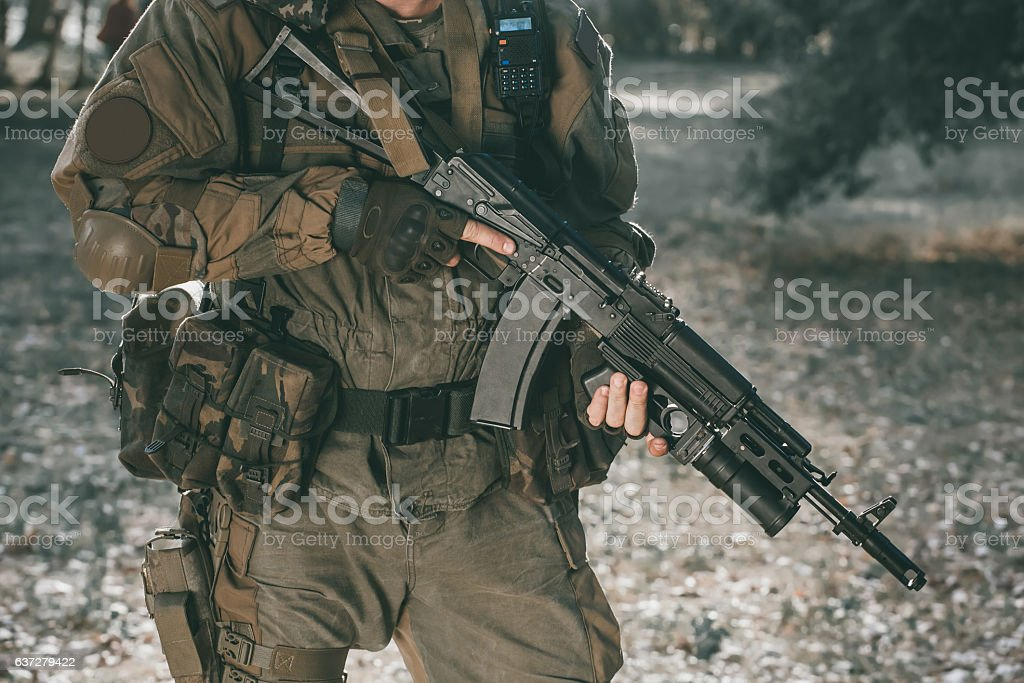 Soldier in camouflage with a gun. stock photo