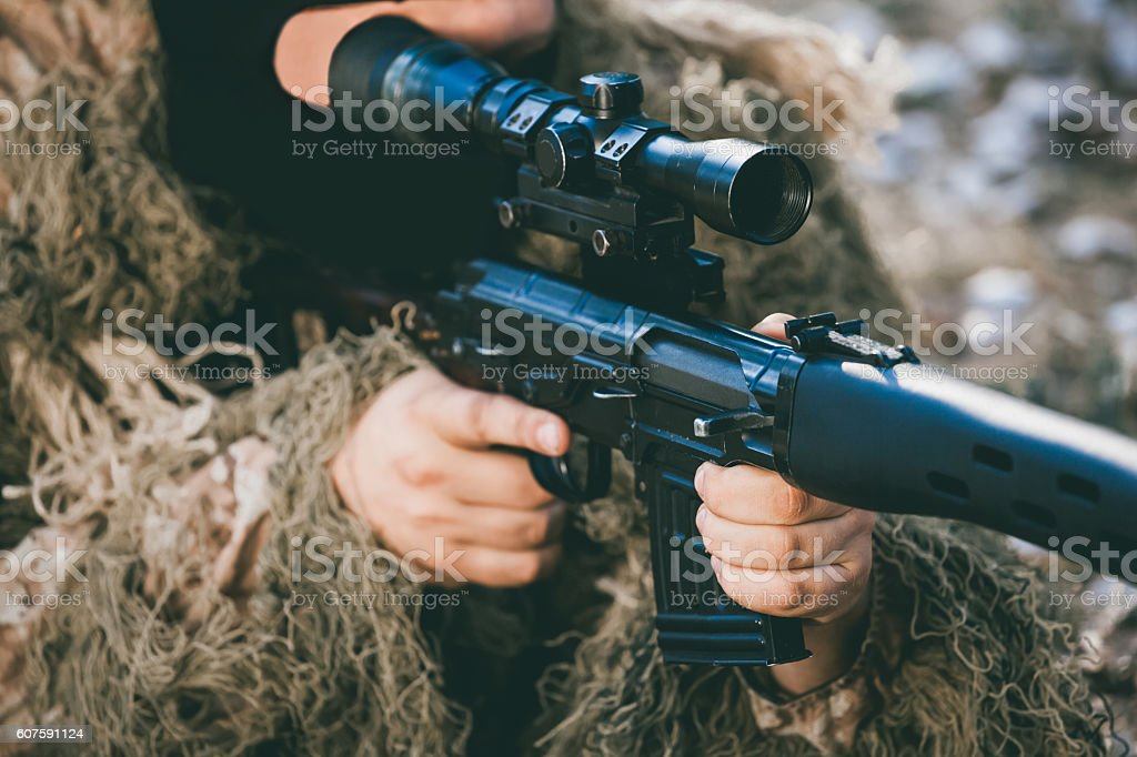 Soldier in camouflage with a sniper rifle. stock photo