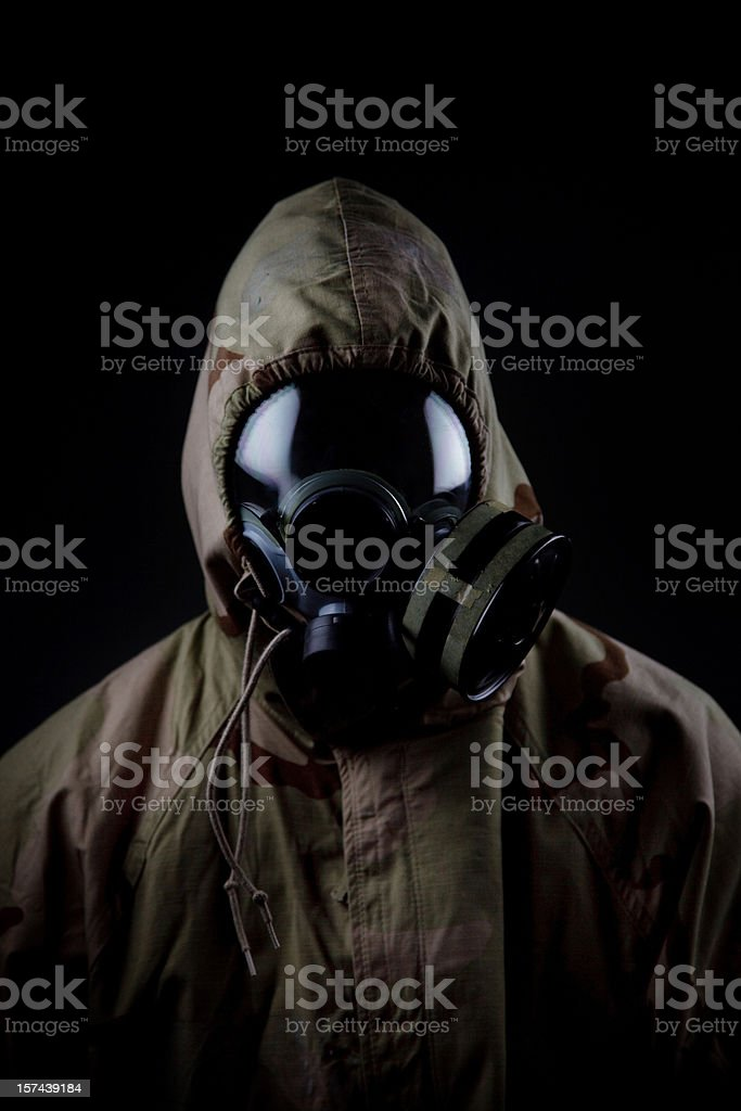 US Soldier in Chemical Warfare Suit stock photo