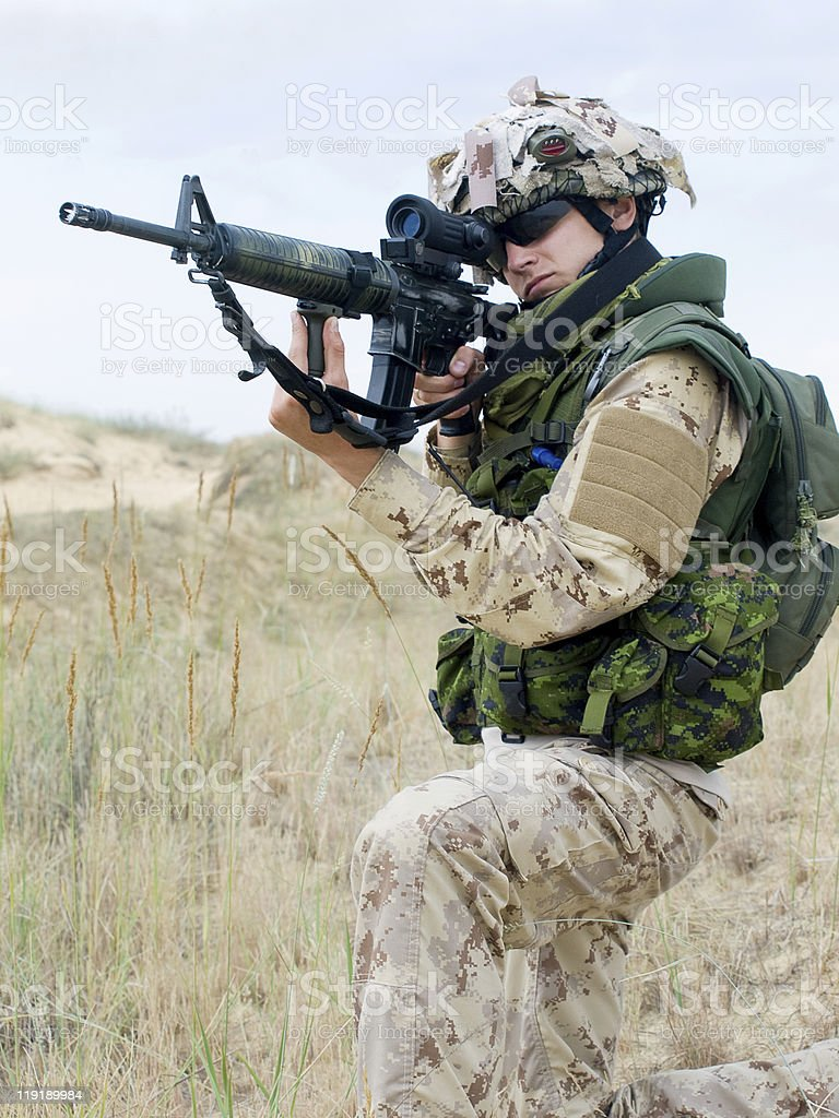 soldier in desert uniform royalty-free stock photo