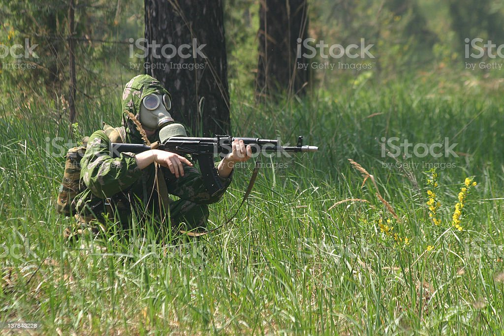 Soldier in gas mask with Kalashnikov royalty-free stock photo