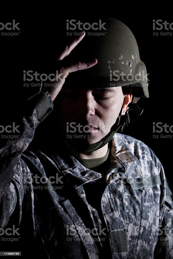 Soldier in Helmet Suffering from PTSD royalty-free stock photo