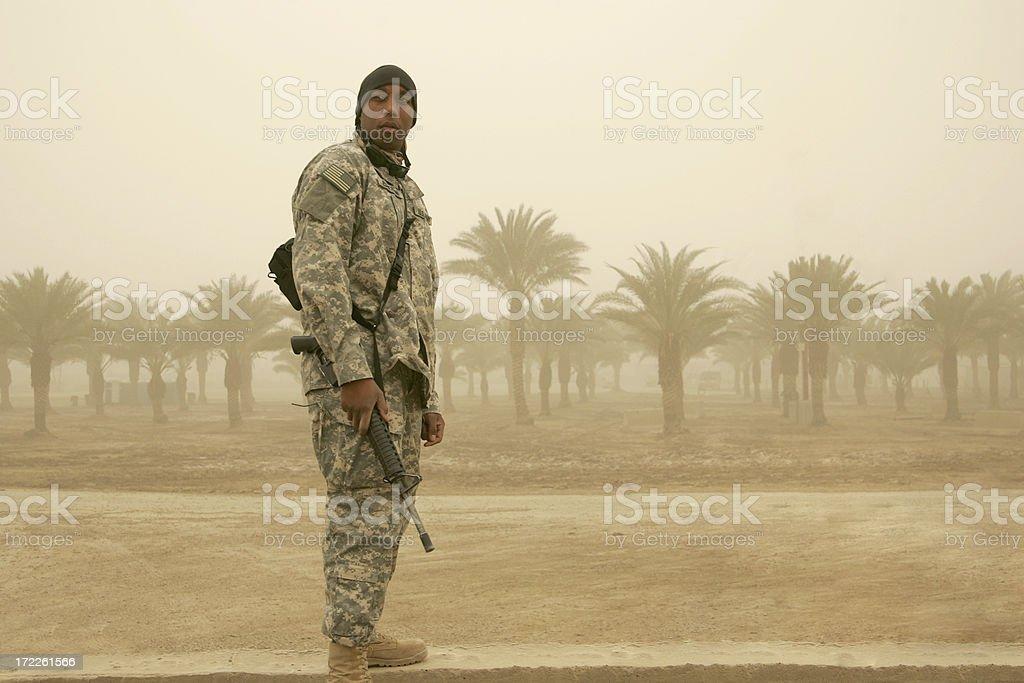 Soldier in Sandstorm no mask stock photo