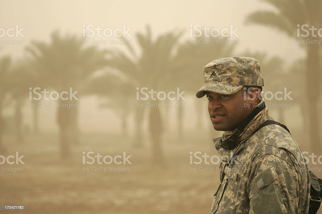 Soldier in Sandstorm Straining to See royalty-free stock photo
