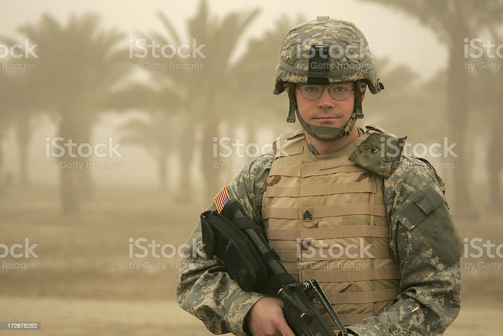 Soldier in Sandstorm with Body Armor royalty-free stock photo