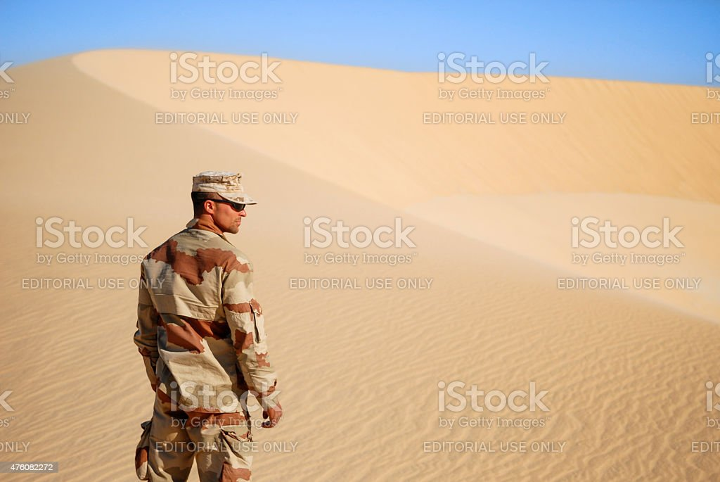 Soldier in the desert stock photo