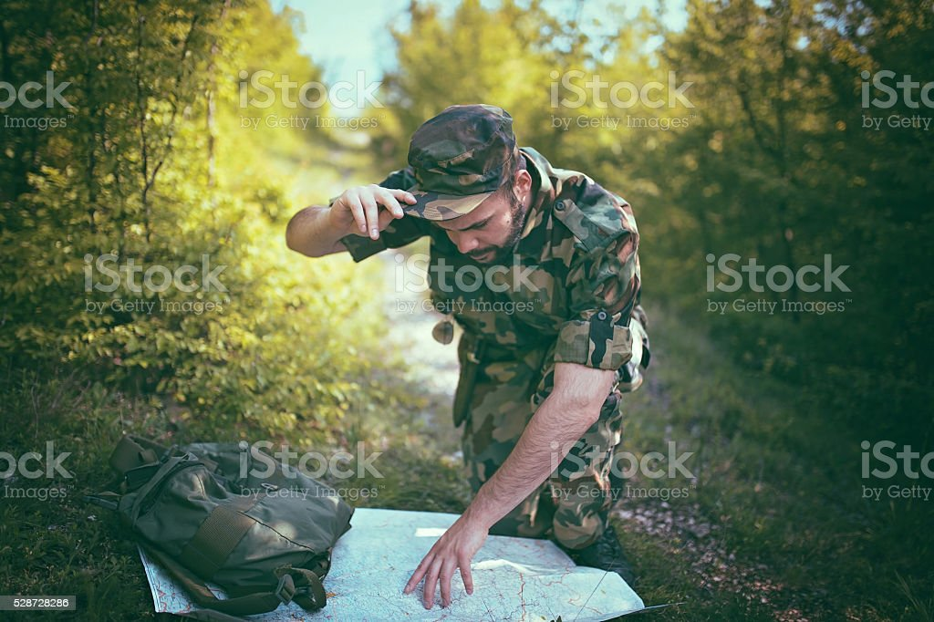 Soldier in the forest stock photo