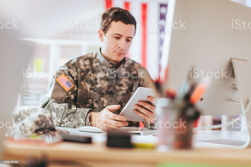 Soldier in the office stock photo