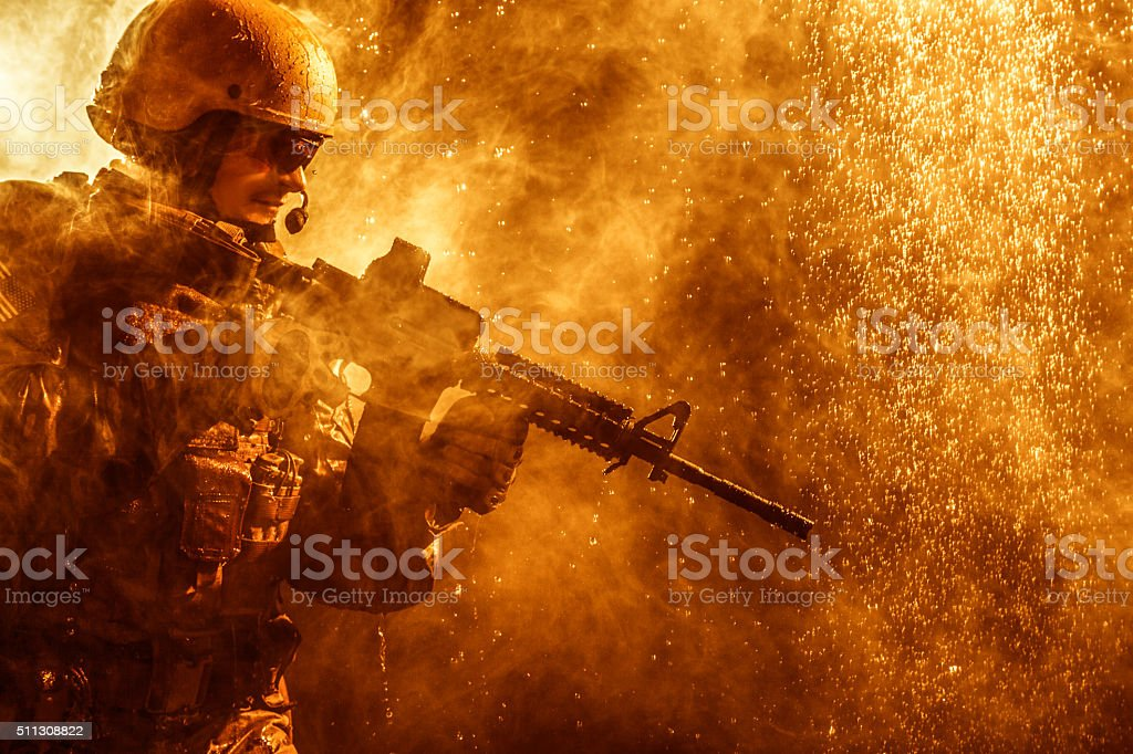 soldier in the rain stock photo
