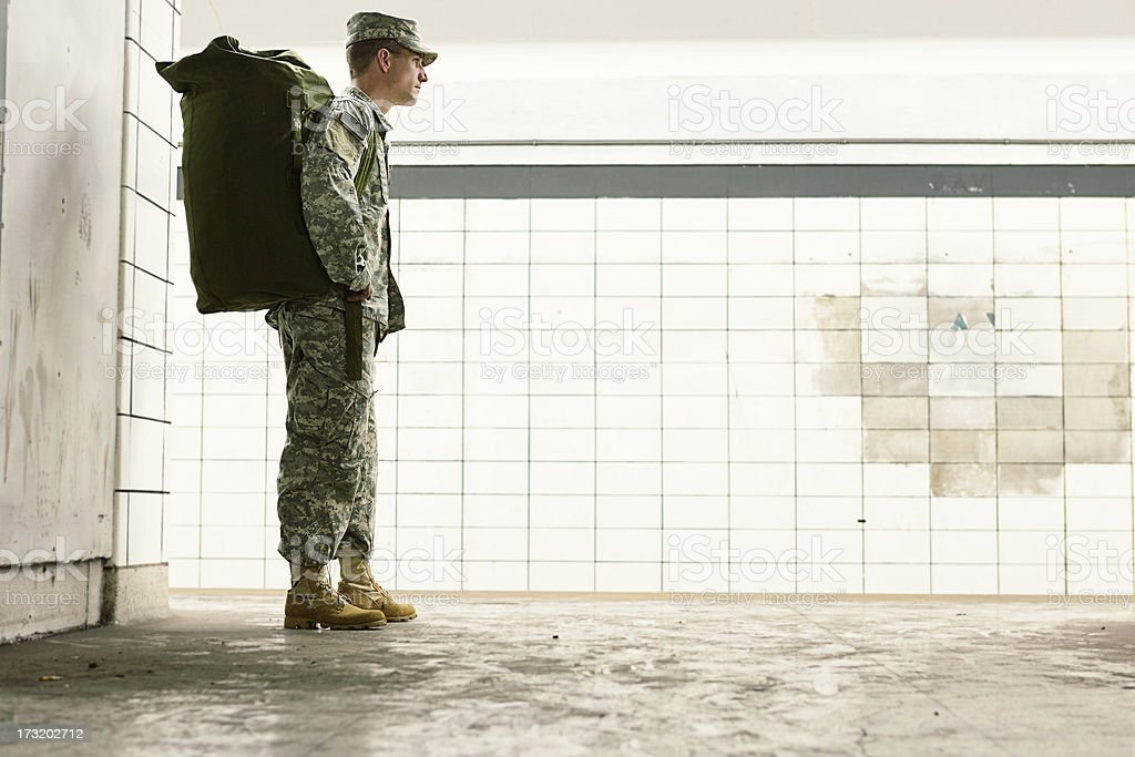 Soldier in the subway stock photo