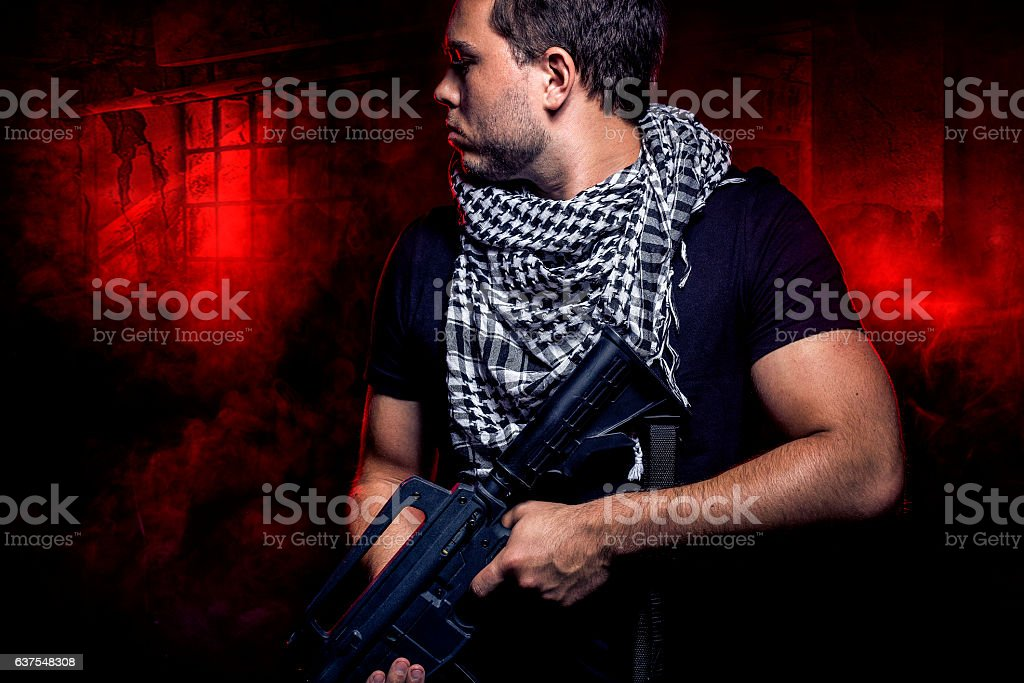 Soldier Invading an Urban Warzone on Fire stock photo