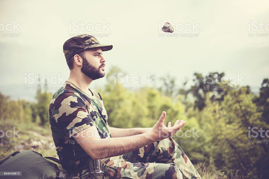 Soldier is bored stock photo