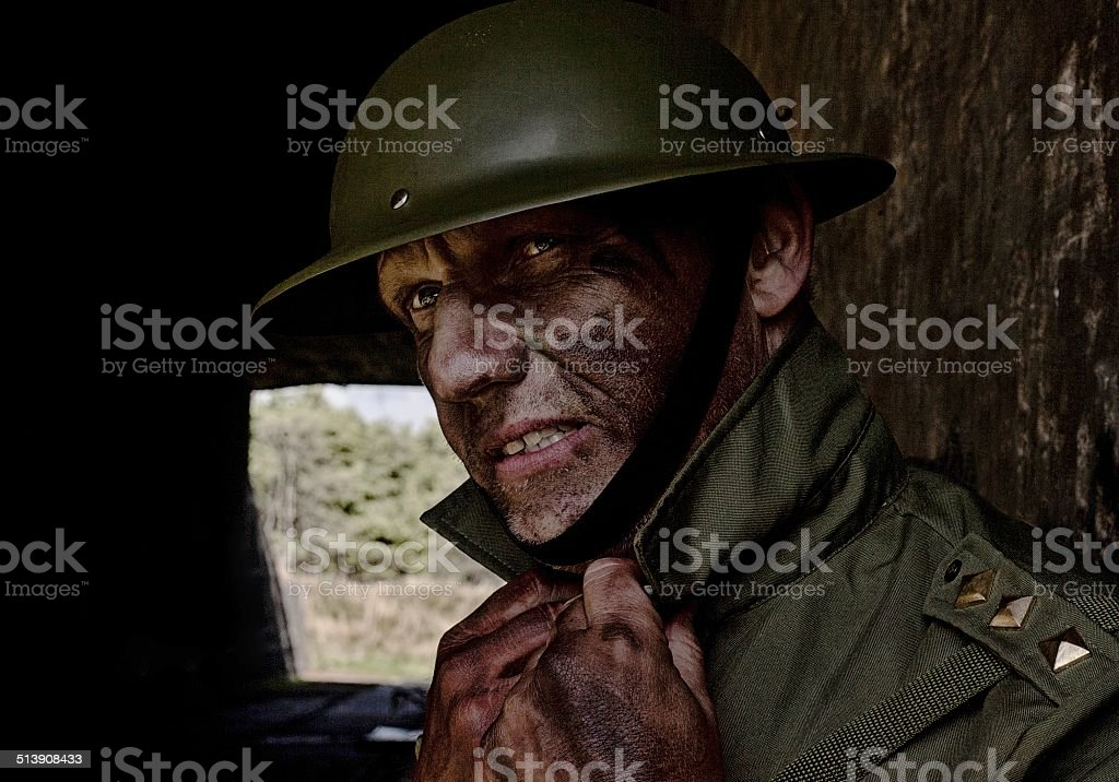 soldier leaning against a wall of a bunker stock photo